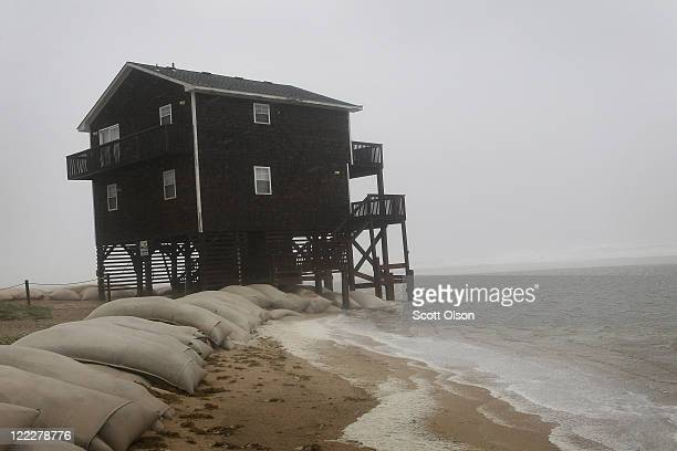 Beach-front cottage is pounded by wind and rain from Hurricane Irene August 27, 2011 in Nags Head, North Carolina. The eye of the hurricane is...