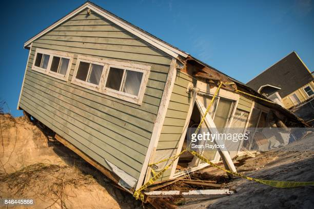 Beachfront home shows damage from Hurricane Irma on September 13, 2017 in Vilano Beach, Florida. About half of homes and businesses in Florida remain...