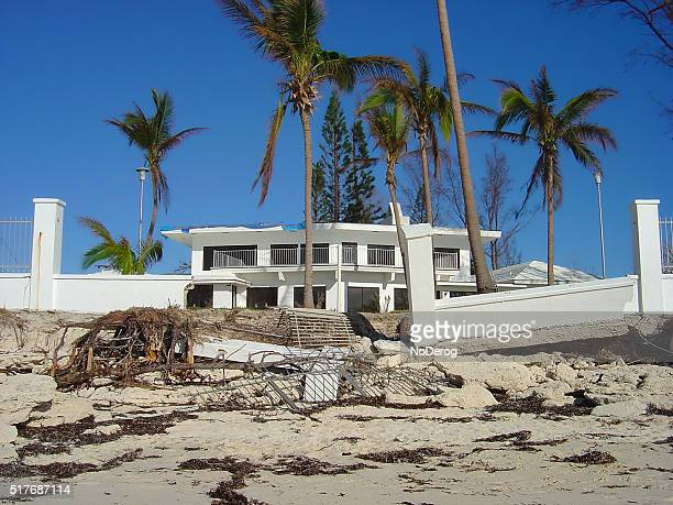 Beachfront property in Bahamas damaged by hurricane winds and waves