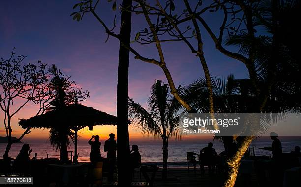 A beachfront restaurant at the Ngapali Bay resort as the sunsets November 28 2012 on Ngapali beach Myanmar Myanmar possesses great tourist potential...