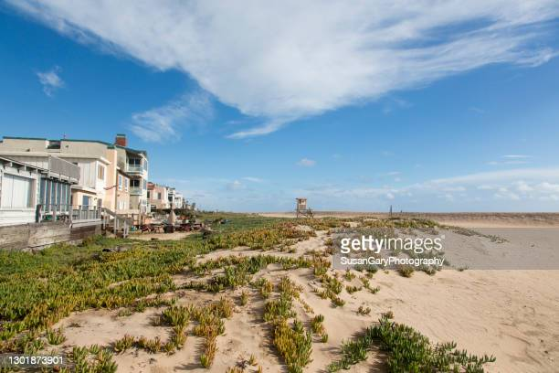 beachfront view on the sand after rainstorm clears out - image title stock pictures, royalty-free photos & images
