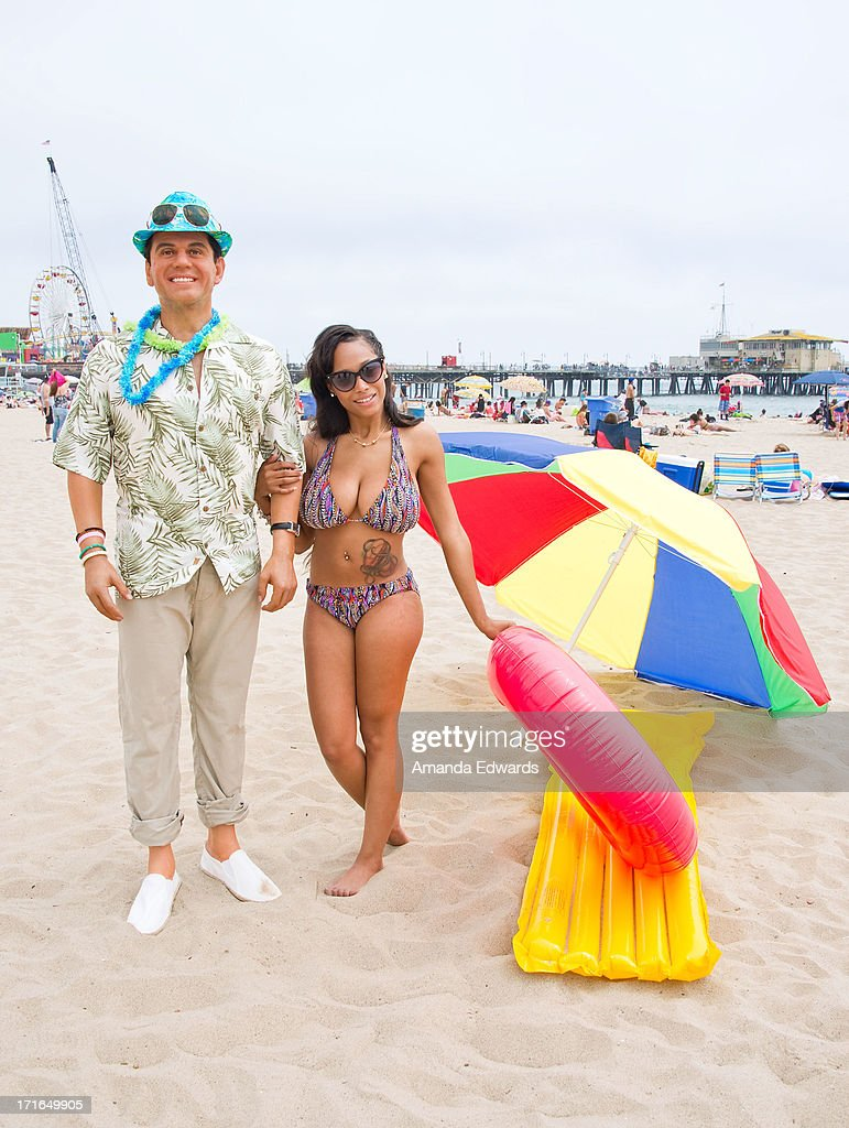 A beachgoer and a wax figure of outgoing Los Angeles Mayor Antonio Villaraigosa enjoy 'A Day At The Beach' compliments of Madame Tussauds Hollywood at Santa Monica Pier on June 26, 2013 in Santa Monica, California.