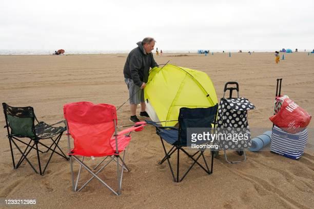 Beachgoer erects a beach tent in Skegness, U.K., on Monday, May 31, 2021. U.K. Health Secretary Matt Hancock said people who want to go on holiday...