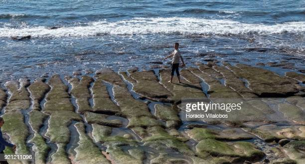 A beachgoer exercises by the sea during mild winter weather at Praia da Duquesa on February 18 2018 in Cascais Portugal Mild and sunny winter weather...