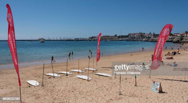 Beachgoers and paddle boards at Praia da Duquesa on April 16 2017 in Cascais Portugal Although active all year round Portuguese tourist industry is...