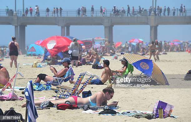 Beachgoers and sunbathers crowd Huntington Beach California on July 22 2016 during a southern California heatwave where temperatures topped 100...