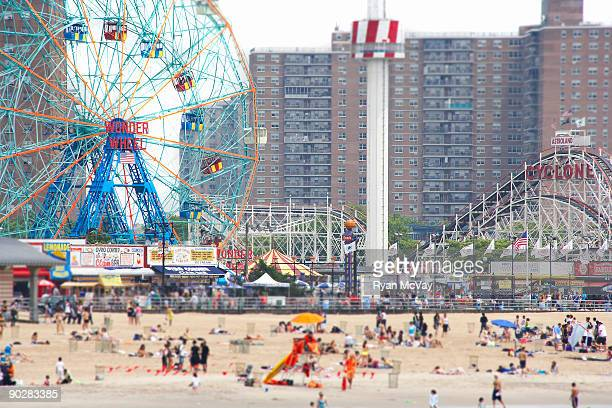 beachgoers at coney island - coney island stock pictures, royalty-free photos & images