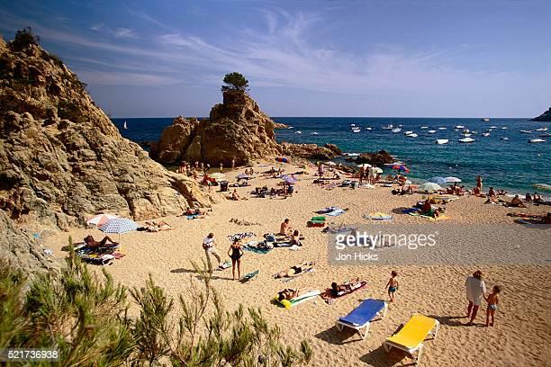 Beachgoers at Platja de Mar Menuda