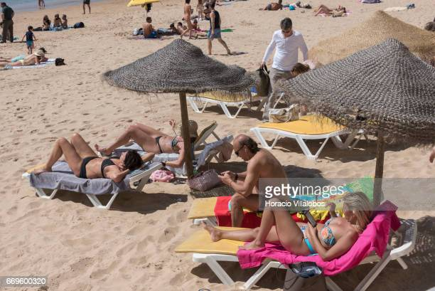 Beachgoers at Praia da Duquesa on April 16 2017 in Cascais Portugal Although active all year round Portuguese tourist industry is hoping for an...