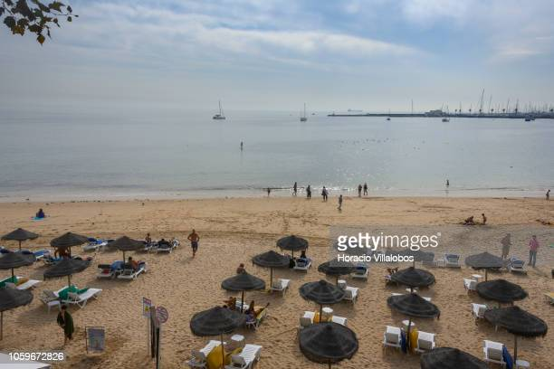 Beachgoers at Praia da Duquesa take advantage of mild autumn weather on October 25 2018 in Cascais Portugal Tourists and locals can be seen going to...