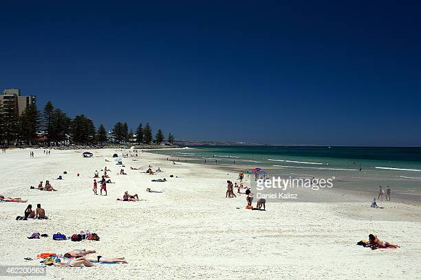 Beachgoers cool off during a heat wave at Glenelg beach on January 13 2014 in Adelaide Australia Temperatures are expected to be over 40 degrees...