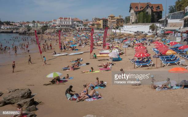 Beachgoers crowd Praia da Duquesa on August 23 2017 in Cascais Portugal Many beaches are one of many attractions the country offers to tourism...