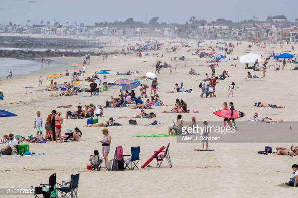 Beach-goers enjoy a partially-sunny, warm day on the beach near the pier in Newport Beach, CA, on April 28, 2020. Newport Beach City Council members...