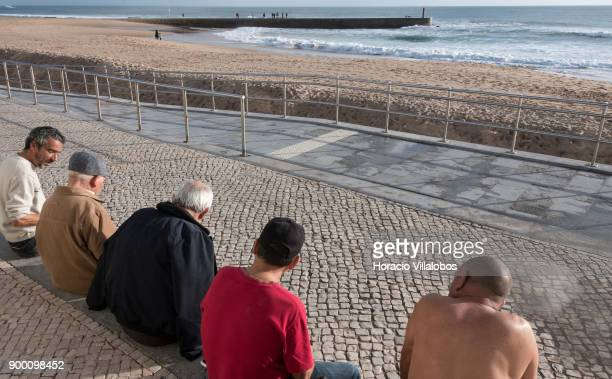 Beachgoers enjoy the afternoon sun and good weather during the last day of the year in Tamariz Beach on December 31 2017 in Estoril Portugal Estoril...