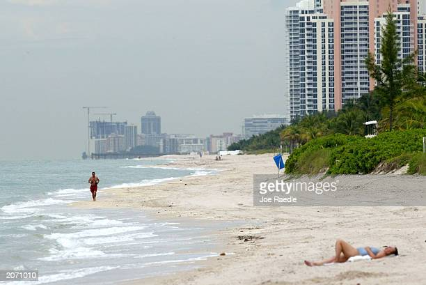 Beachgoers enjoy the beach as condos line the ocean front June 10 2003 in Hollywood Florida According to the Pew Oceans Commission report released...