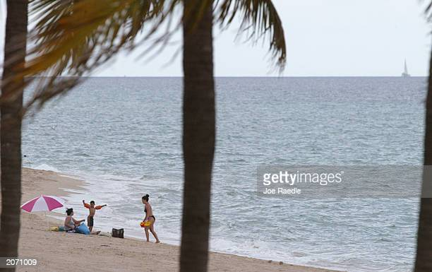 Beachgoers enjoy the beach June 10 2003 in Hollywood Florida According to the Pew Oceans Commission report released recently America's oceans are in...
