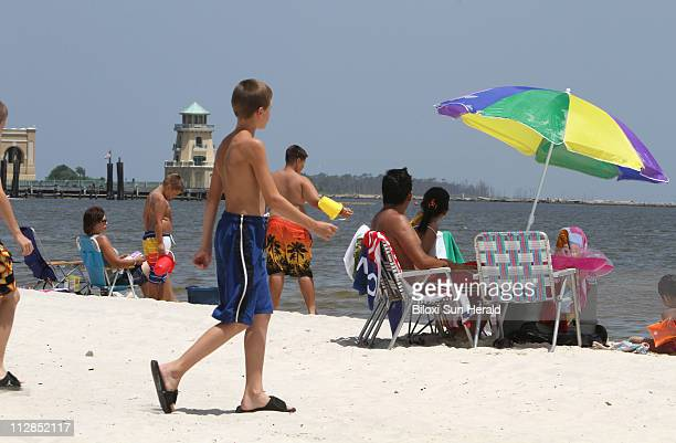 Beachgoers enjoy the sun and sand in Biloxi Mississippi on Thursday July 22 as BP contractors look for signs of oil Residents along the Mississippi...