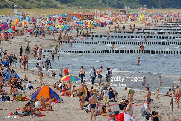 Beachgoers enjoy the sun and surf at Warnemuende beach in Rostock Germany Saturday August 19 2006 As many as 12 million Germans who go to nude...
