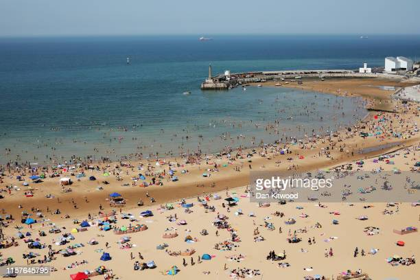 Beachgoers enjoy the sunshine on July 25 2019 in Margate United Kingdom The Met Office issued a weather warning from 3pm this afternoon They warn...
