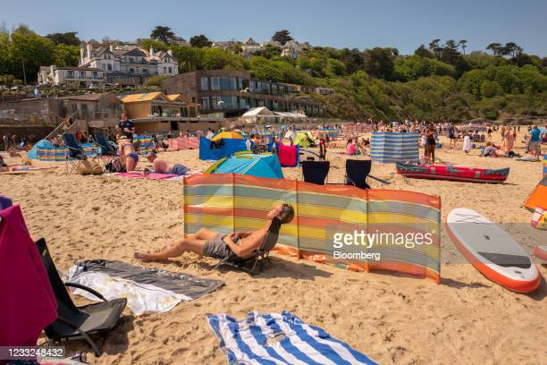 Beach-goers in front of the Carbis Bay Hotel and Resort, the venue for the upcoming Group of Seven leaders summit, in Carbis Bay, U.K., on Thursday,...
