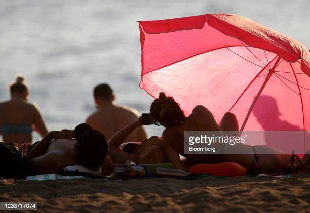 Beachgoers on English Bay Beach during a heatwave in Vancouver, British Columbia, Canada, on Monday, June 28, 2021. The heat is expected to continue...
