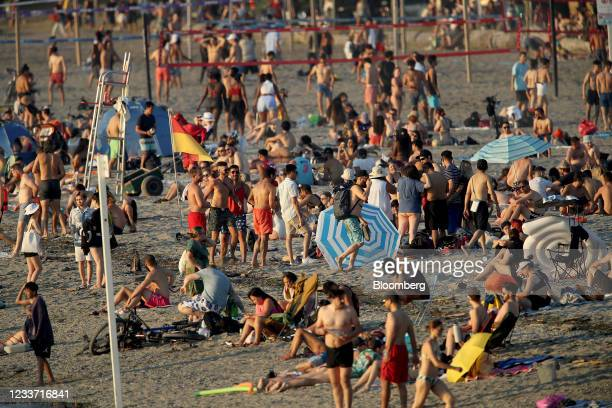 Beachgoers on Kitsilano Beach during a heatwave in Vancouver, British Columbia, Canada, on Monday, June 28, 2021. The heat is expected to continue...