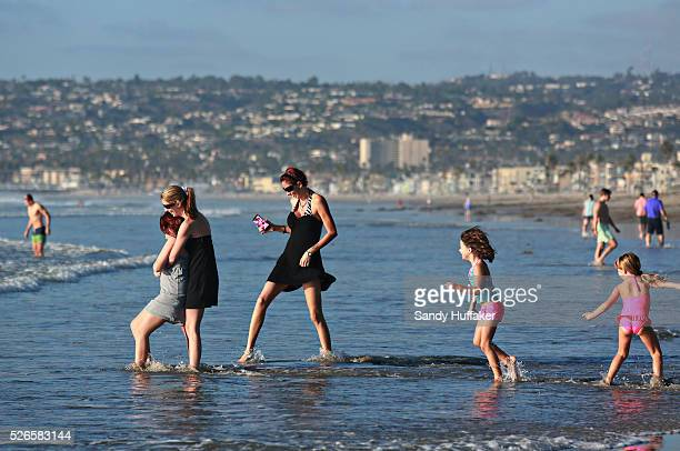 Beachgoers play in the surf along Mission Beach in San Diego CA on Monday October 27 2014