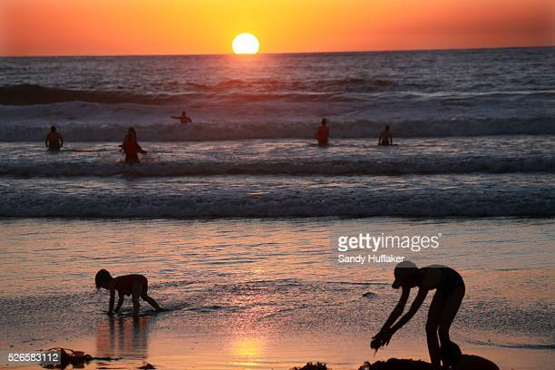 Beachgoers play in the surf along the shore Mission Beach in San Diego CA on Monday October 27 2014