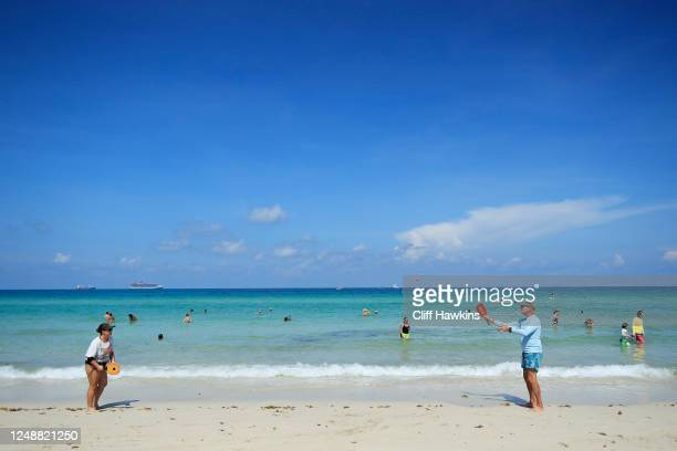 Beachgoers play paddle-ball on South Beach on June 10, 2020 in Miami Beach, Florida. Miami-Dade county and the City of Miami opened their beaches...