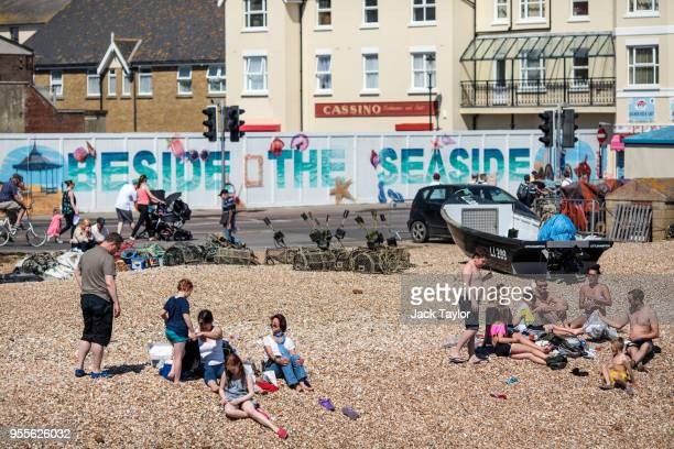 Beachgoers relax on the beach during the warm weather on Bank Holiday Monday on May 7, 2018 in Bognor Regis, United Kingdom. Britons across the...