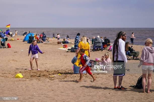 Beachgoers relax on the beach in Skegness, U.K., on Monday, May 31, 2021. U.K. Health Secretary Matt Hancock said people who want to go on holiday...