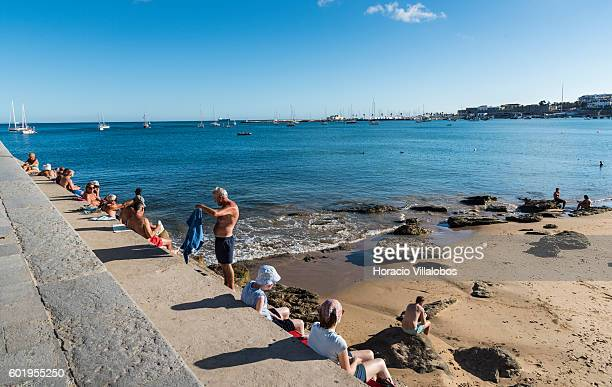 Beachgoers sunbathe in Praia da Duquesa on September 09 2016 in Cascais Portugal Although active all year round Portuguese tourist industry is having...