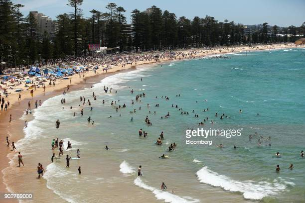 Beachgoers swim at Manly Beach in Sydney Australia on Friday Jan 5 2018 The Australian Bureau of Statistics is scheduled to release monthly retail...