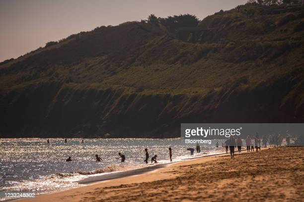 Beach-goers swim near the Carbis Bay Hotel and Resort, the venue for the upcoming Group of Seven leaders summit, in Carbis Bay, U.K., on Thursday,...