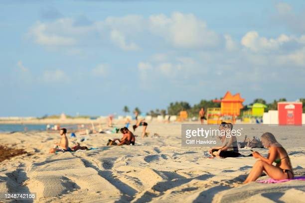 Beachgoers take advantage of the opening of South Beach on June 10, 2020 in Miami Beach, Florida. Miami-Dade county and the City of Miami opened...