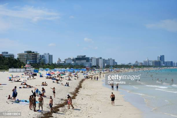 Beachgoers take advantage of the opening of South Beach on June 10 2020 in Miami Beach Florida MiamiDade county and the City of Miami opened their...