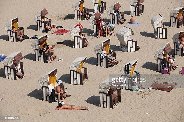 Beachgoers take in the sun at a beach on the Baltic Sea on Ruegen Island on April 22 2011 at Sellin Germany Most of Germany basked in spring sunshine...