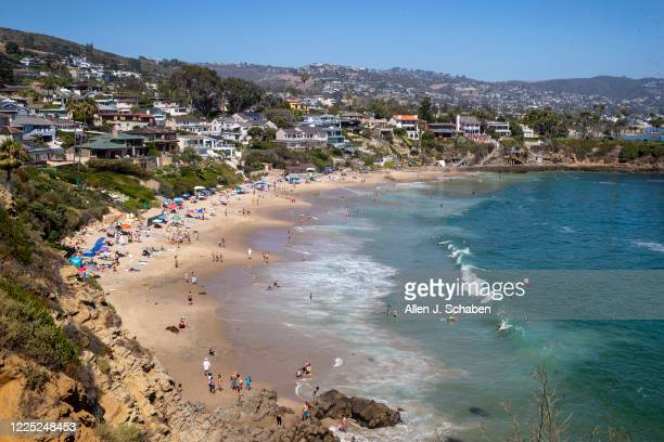 Beach-goers take to the waves at Crescent Bay Beach Monday, July 6, 2020 in Laguna Beach as SoCal beaches reopen after being closed to help reduce...