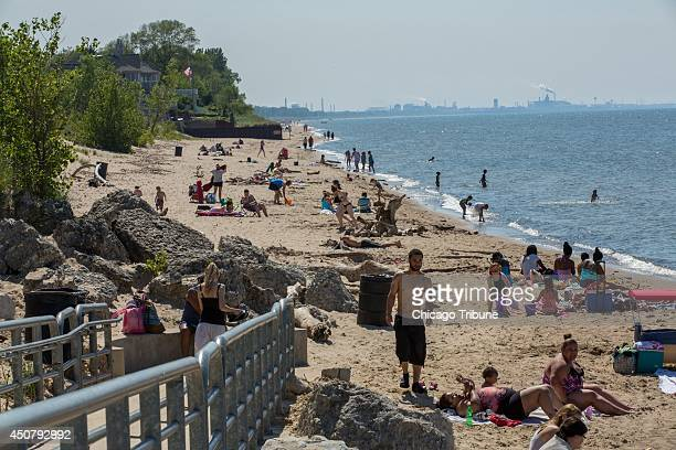 Beachgoers visit a popular beach at Portage Lakefront and Riverwalk at the Indiana Dunes National Lakeshore in Portage June 6 2014