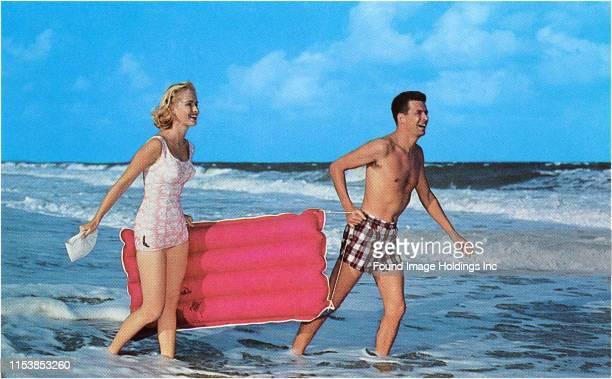 Beachgoers with Raft