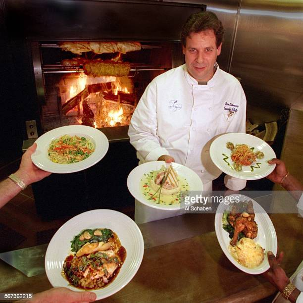 BEACHTwin Palms executive chef Don Dickman shows dishes from left Vermicelli pasta with Julienne vegetables pine nutsgarlic olive oil cream saucedish...
