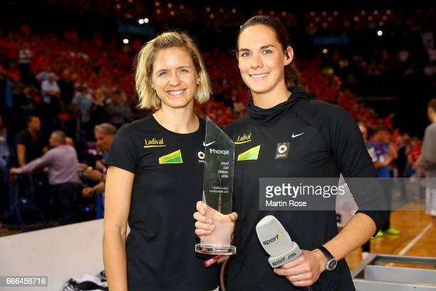 Beachvolley ball gold medalist of Rio 2016 Laura Ludwig and Kira Walkenhorst pose with the sport1 trophy during the Rewe Final Four final match...