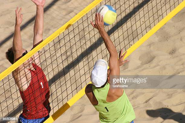 beachvolley two players duel at the net - beachvolleybal stockfoto's en -beelden