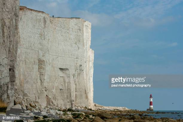 beachy head lighthouse and coastline - beachy head stock photos and pictures