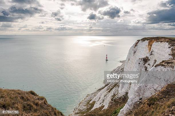 beachy head lighthouse and the english channel - english channel stock photos and pictures