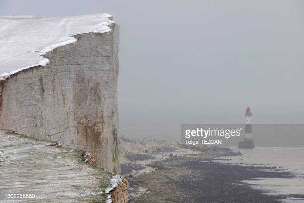 4k: beachy head lighthouse, winter scene, eastbourne - suicide stock pictures, royalty-free photos & images