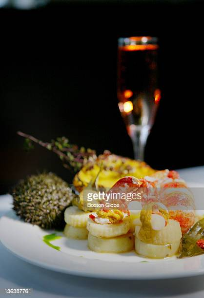 Beacon Hill Bistro offers a New Year's Eve main course of Mass soft shell lobster with sea urchin bisque baby acorn squash celeriac and potato confit...