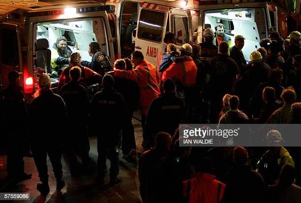 Tasmanian miners Todd Russell and Brant Webb sit in ambulances after being rescued from Beaconsfield gold mine after 14 days early 09 May 2006 in...
