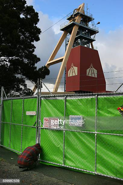 Beaconsfield Mine 2006 An unidentified woman prays at the gate at the Beaconsfield Mine for two miners Brant Webb and Todd Russell who have been...