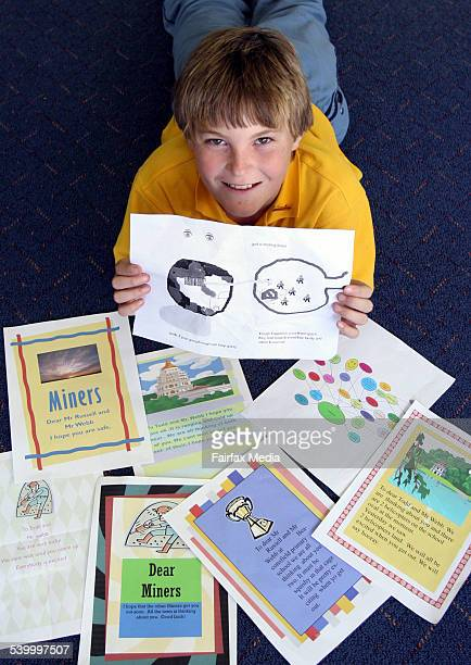 Beaconsfield Mine 2006 Beaconsfield Primary School student Luke Johnston with his artwork and the work of his classmates relating to the mine rescue...